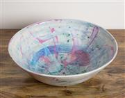 Sale 8489A - Lot 34 - A studio pottery bowl with mark/initials to base with pink, mauve and green abstract design, D 30cm