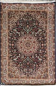 Sale 8868 - Lot 1131 - Small Probably Turkish Silk on Silk Carpet, with profuse floral arabesques on a black ground with cream border (190 x 121cm)