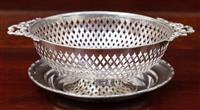 Sale 8963H - Lot 84 - A finely pieced sterling silver bowl with ribbon handles, Birmingham maker S Star B together with a small tray Sheffield maker E V,...