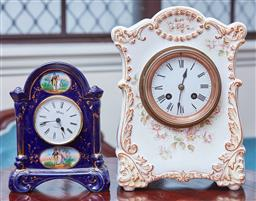 Sale 9103M - Lot 478 - A floral decorated ceramic mantle clock, Height 27cm, chip to arch, together with a blue and gilt example with Aynsley clock face, H...