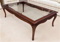 Sale 9155H - Lot 8 - A carved coffee table with rope edgings, fitted with a bevelled glass top, Height 45.5cm x Width 150cm x Depth 90cm, purchased from...