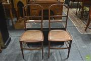 Sale 8317 - Lot 1055 - Pair of Edwardian Mahogany Ladder-Back Chairs with caned seats & splayed feet