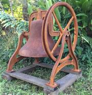 Sale 8579 - Lot 63 - A large cast iron bell with wheel on timber base, L 74 x W 53 x H 83cm