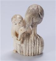 Sale 8376A - Lot 85 - Ivory netsuke of Man feeding a stork, bearing exquisite detail, signed to base,  Ht: 4.0cm L: 2.5cm