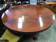 Sale 8666 - Lot 1080 - Early Victorian Mahogany Supper Table, the round flame veneered top above a facted pedestal, on round base with paw feet