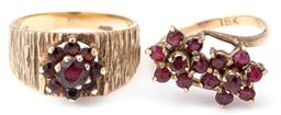 Sale 9124 - Lot 349 - TWO 9CT GOLD BOHEMIAN GARNET CLUSTER RINGS; one a cluster set on tapered textured band hallmarked London 1992, size R, other a doubl...