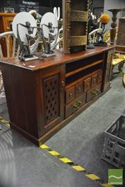 Sale 8398 - Lot 1061 - Timber Entertainment Cabinet with Lattice Doors to Sides & Seven Central Drawers