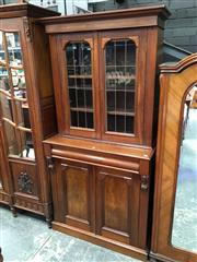 Sale 8666 - Lot 1073 - Late 19th Century Cedar & Walnut Bookcase, the walnut top with two leadlight doors, above a frieze drawer & two panel doors