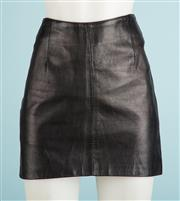 Sale 9071F - Lot 94 - A BLACK LEATHER SKIRT zip to back size 12