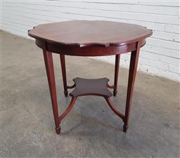 Sale 9142 - Lot 1048 - Late Victorian/ Edwardian mahogany Occasional Table, the shaped generally circular top with cross-banded edge, raised on tapering le...