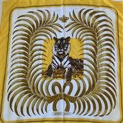 Sale 8694A - Lot 50 - An Hermes silk scarf printed with a Tigre du Bengal against a canary yellow ground, H 86 x W 86cm