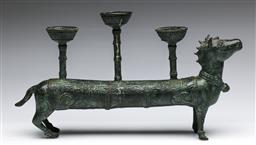 Sale 9173 - Lot 39 - A bronze figural three-branch candle-holder (L: 40cm)