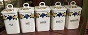 Sale 8319 - Lot 408 - 1960s set of 5 ceramic kitchen jars all labelled and with covers