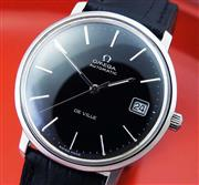 Sale 8387A - Lot 44 - A fine vintage mens Omega De Ville black dial wristwatch. Automatic 35.7 mm. Polished stainless case and black leather strap. Fully...