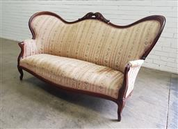 Sale 9142 - Lot 1062 - 19th Century Possibly German Mahogany Settee, with high carved back, upholstered in striped cream fabric, raised on cabriol legs - u...