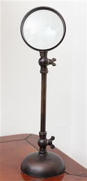 Sale 8902H - Lot 47 - A patinated brass magnifier on stand with adjustable lamp 40cm