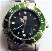 Sale 8387A - Lot 47 - A vintage mens Tag Heuer professional dive wristwatch. Stainless steel with green bezel. Quartz movement. Keeping accurate time. 40...
