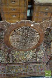 Sale 8460 - Lot 1095 - Kashmiri Walnut Oval Firescreen, possibly carved irises & grape vines