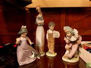 Sale 8582 - Lot 2320 - 4 Nao LLadro Figurines: Boy with Soccer Ball, Woman Nursing Duck, Girl Playing with Dog & Clown