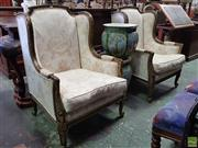 Sale 8617 - Lot 1054 - Pair of French Transitional Style Gilt Armchairs, in a distressed finish, upholstered in a print fabric with 18th century motifs & o...