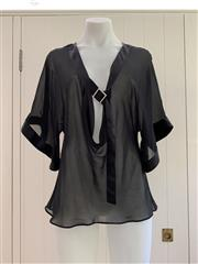 Sale 8694A - Lot 66 - An Emporio Armani sheer black (presumed) silk tie-neck blouse with satin trim, approx size 8/10