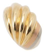 Sale 9037 - Lot 345 - A THREE TONE 18CT GOLD RING; reeded top to a shoulder featuring white and pink gold stripes, width at top 12.3mm, size N1/2, wt. 7.98g.