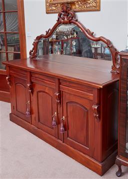 Sale 9103M - Lot 483 - A bevelled mirror topped timber credenza with a fleur de lys surmount, Height 167cm x Width 170cm x Depth 47.5cm