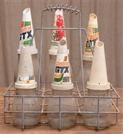 Sale 8984H - Lot 50 - A Metal six bay oil basket containing six glass oil bottles with funnels, all marked Castrol. 3 x 1 quart and 3 x 100ml. Height of l...