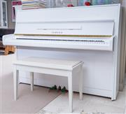Sale 8593A - Lot 64 - A Yamaha white upright piano, of good tone, in good condition, W 150cm, together with a stool, and music (Please see sale comments f...