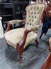 Sale 8925 - Lot 1085 - An edwardian sage green button back elbow chair on castors