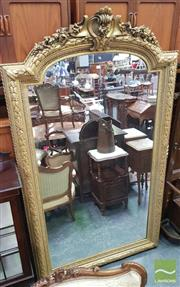 Sale 8416 - Lot 1024 - Large Late 19th French Eclectic Gilt Framed Mirror, with tied laurel border, the arched top with scroll & floral pendants, 232 x 132 cm