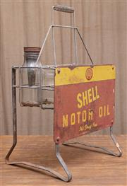 Sale 8984H - Lot 52 - An eight bay metal oil bottle raised  basket with Shell motor oil signage, approx 67cm total height.