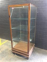Sale 9031 - Lot 1079 - Early 20th Century Tall Oak & Glass Shop Display Cabinet, of square section, with single door & raised on tapering legs (small crack...