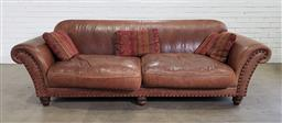 Sale 9191 - Lot 1001 - Brown leather 2 seater lounge by Molmic - throw cushions not included (h:85 x w:250 x d:100cm)