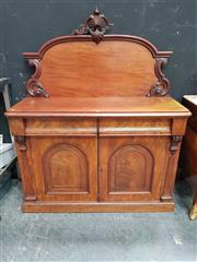 Sale 8669 - Lot 1012 - Victorian Mahogany Chiffonier, with carved back, two drawers & two arched panel doors