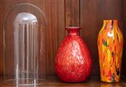 Sale 9058H - Lot 84 - A studio glass bottle vase of baluster shape with aventuirine inclusions together with an orange example and a cloche.
