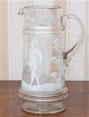 Sale 9058H - Lot 96 - A Mary Gregory style white enamelled jug with youth carrying a hoop and stick decoration.
