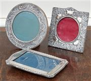 Sale 9081H - Lot 23 - A collection of antique English sterling silver photo frames, largest diameter 16cm (one stand on back broken)