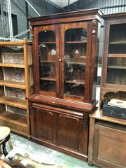 Sale 8676 - Lot 1185 - Late 19th Century Cedar Bookcase, with two glass panel doors, frieze drawer & two arched panel doors