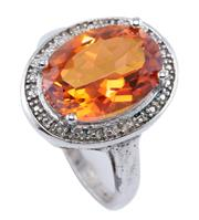 Sale 8954 - Lot 312 - A CITRINE AND DIAMOND COCKTAIL RING; set in silver with  an oval cut coated golden citrine of approx. 5.18ct and single cut diamonds...
