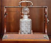 Sale 9058H - Lot 87 - An Edwardian tantalus with single bottle with hobnail decoration. H-30cm W-36.5cm