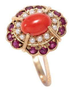 Sale 9246J - Lot 357 - AN EDWARDIAN STYLE CORAL AND GEMSET CLUSTER RING; centring a 7.2 x 5mm oval cabochon coral surrounded by seed pearls and round cut r...