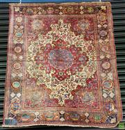 Sale 8576 - Lot 1021 - Vintage Possibly Hereke Wool Carpet, with vase-and-flower motif within red medallion, on a cream field with arabesques, the border i...