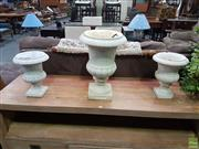 Sale 8601 - Lot 1459 - Graduated Set of Three White Marble Urns, with reeded lower body & square bases. Tallest: 47 cm