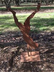 Sale 8782A - Lot 5 - Artist unknown, a Bromley Style metal 2D sculpture of a handstand in rusted iron. Height 110cm x width 56cm