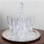 Sale 8470H - Lot 14 - A Kosta Boda cut glass decanter, together with four Stewart Crystal wine glasses on a Strachan EP circular tray, D 35cm