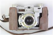 Sale 8761 - Lot 58 - Kodak 35 mm Camera with Anastigmatic Lens