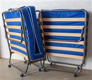 Sale 8782A - Lot 145 - Two matching foldup single beds