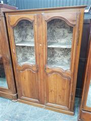 Sale 8868 - Lot 1158 - 19th Century French Oak Cabinet, with two shaped mesh panel doors, lined with 18th century style fabric with garden scenes