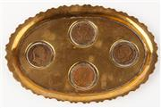 Sale 9048A - Lot 77 - An oval frill edged brass offering dish inlaid with copper pennies depicting victoria George V, George VI and Edward VII, Length 19cm
